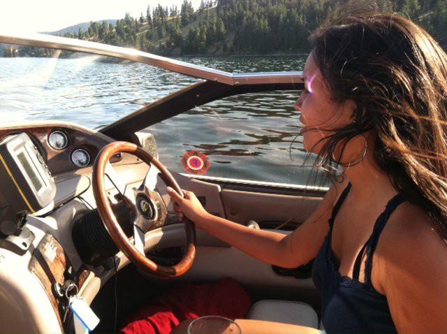 Maya driving Mario's boat on the Flathead Lake in Montana.